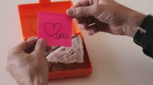 stock-footage-adult-man-opens-lunch-box-with-love-note-closeup
